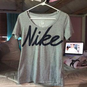 Nike woman gray and purple shirt